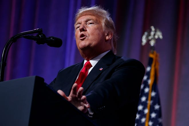 President Donald Trump speaks to the Ohio Republican Party State Dinner, Friday, Aug. 24, 2018, in Columbus, Ohio. (AP Photo/Evan Vucci)