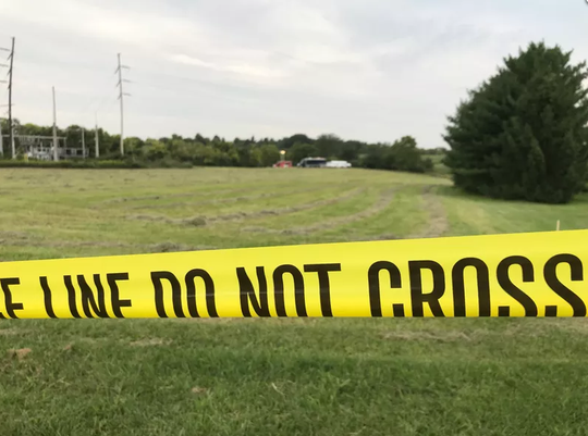 The field in Liberty Township at 6451 Milliken Road where investigators found a body Friday.