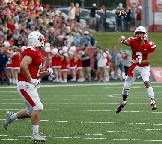 Beechwood quarterback Cameron Hergott, shown in a game against Lloyd last year, struggled in the Sept. 20 game with Covington Catholic.