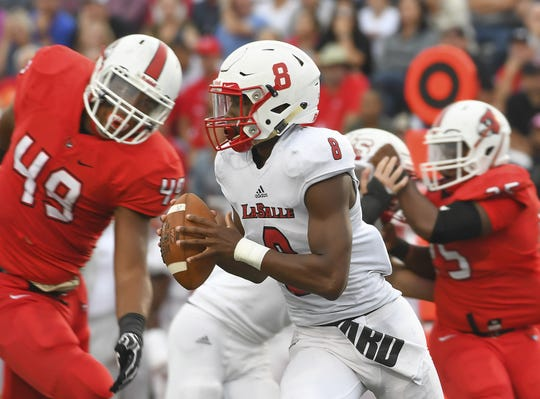 La Salle quarterback MJ Horton (8) is rushed out of the pocket against Colerain in the Skyline Chili Crosstown Showdown, Colerain Township, Friday August 24, 2018