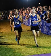 Joe Doogan and Matthew Hoak of St. Xavier finish 1-2 in the varsity large school boys race at the Moeller Primetime Cross Country Invitational, August 24, 2018.
