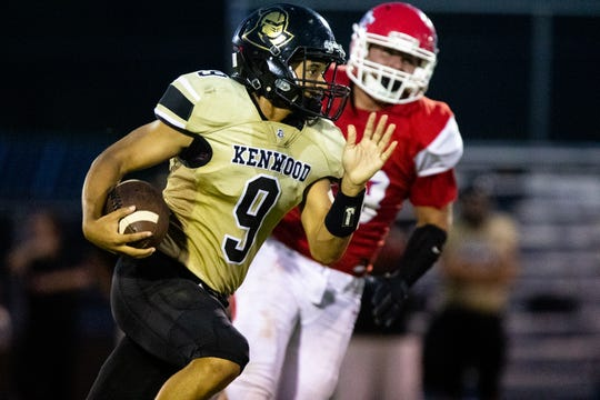 Kenwood's Christopher Williams (9) runs with the ball during the game at Montgomery Central High School Friday, Aug. 24, 2018, in Cunningham, Tenn.