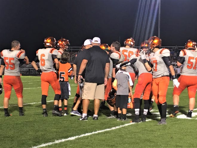 Ridgewood coaches and players huddle during a stoppage in Friday's win over West Salem Northwestern.