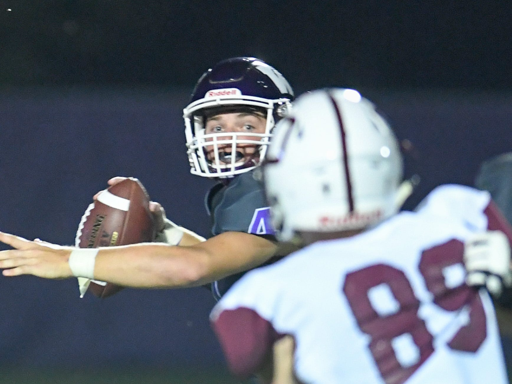 Waukee's Mitch Randall (4) looks for a open receiver on Friday, August 24, 2018 during a football game between the Waukee Warriors and the Dowling Catholic Maroons at Waukee High School.