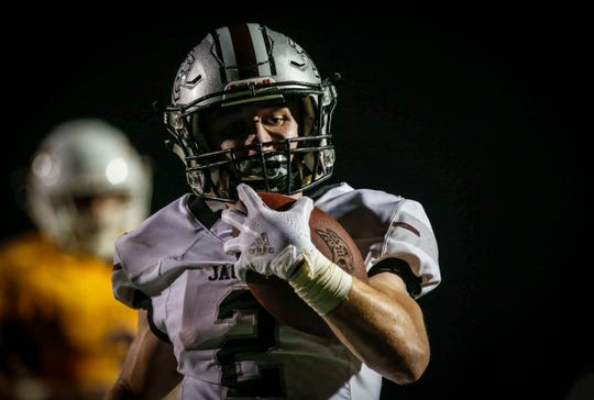 Ankeny Centennial junior running back Avery Gates sprints into the end zone for his third touchdown of the game against Ankeny at Ankeny Stadium on Friday, Aug. 24, 2018.