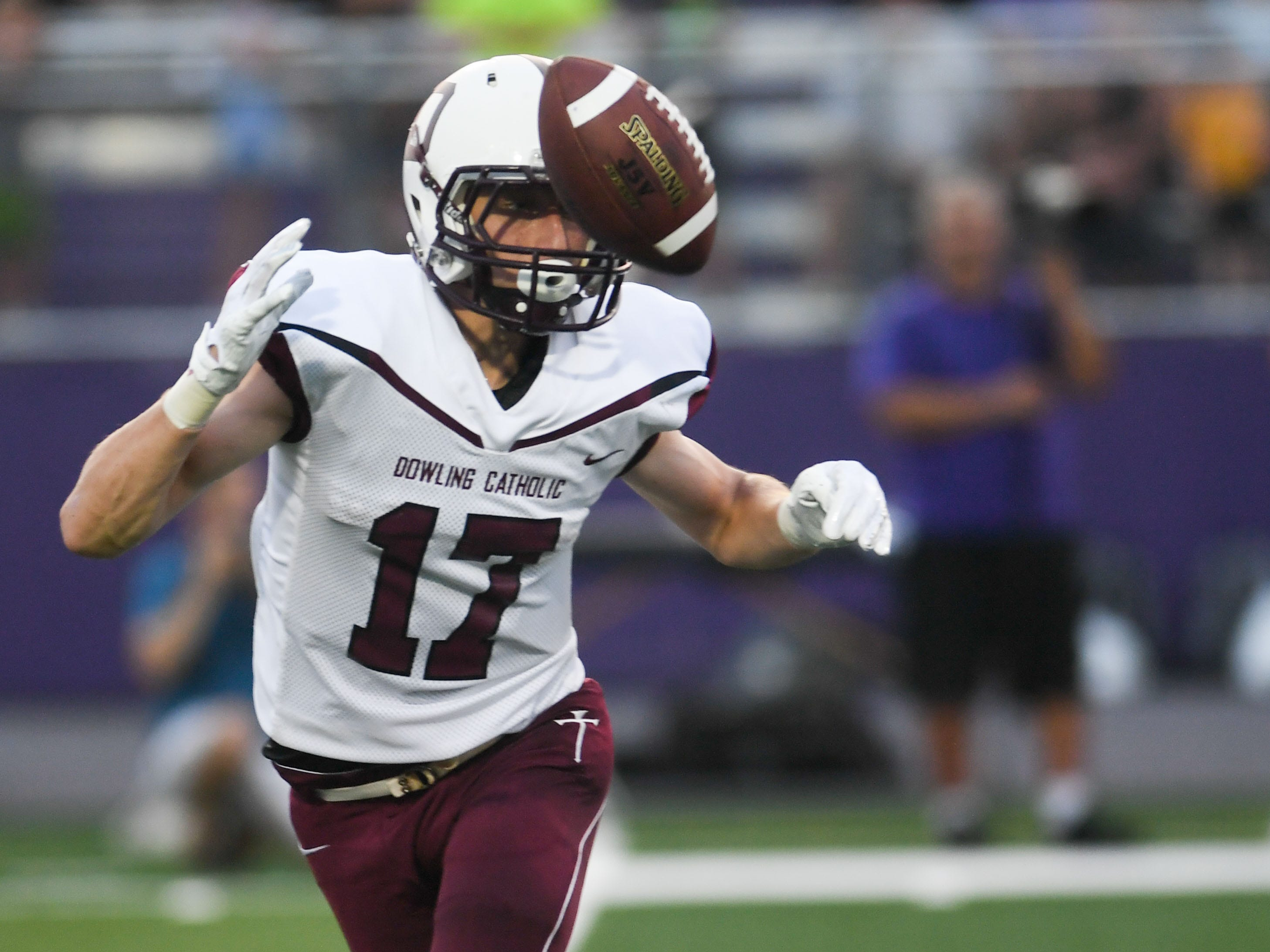 Dowling's Matt Stilwill (17) watches the ball during a kick return on Friday, August 24, 2018 during a football game between the Waukee Warriors and the Dowling Catholic Maroons at Waukee High School.
