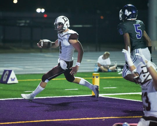 Dowling's Zach Watters (4) runs in for a touchdown on Friday, August 24, 2018 during a football game between the Waukee Warriors and the Dowling Catholic Maroons at Waukee High School.