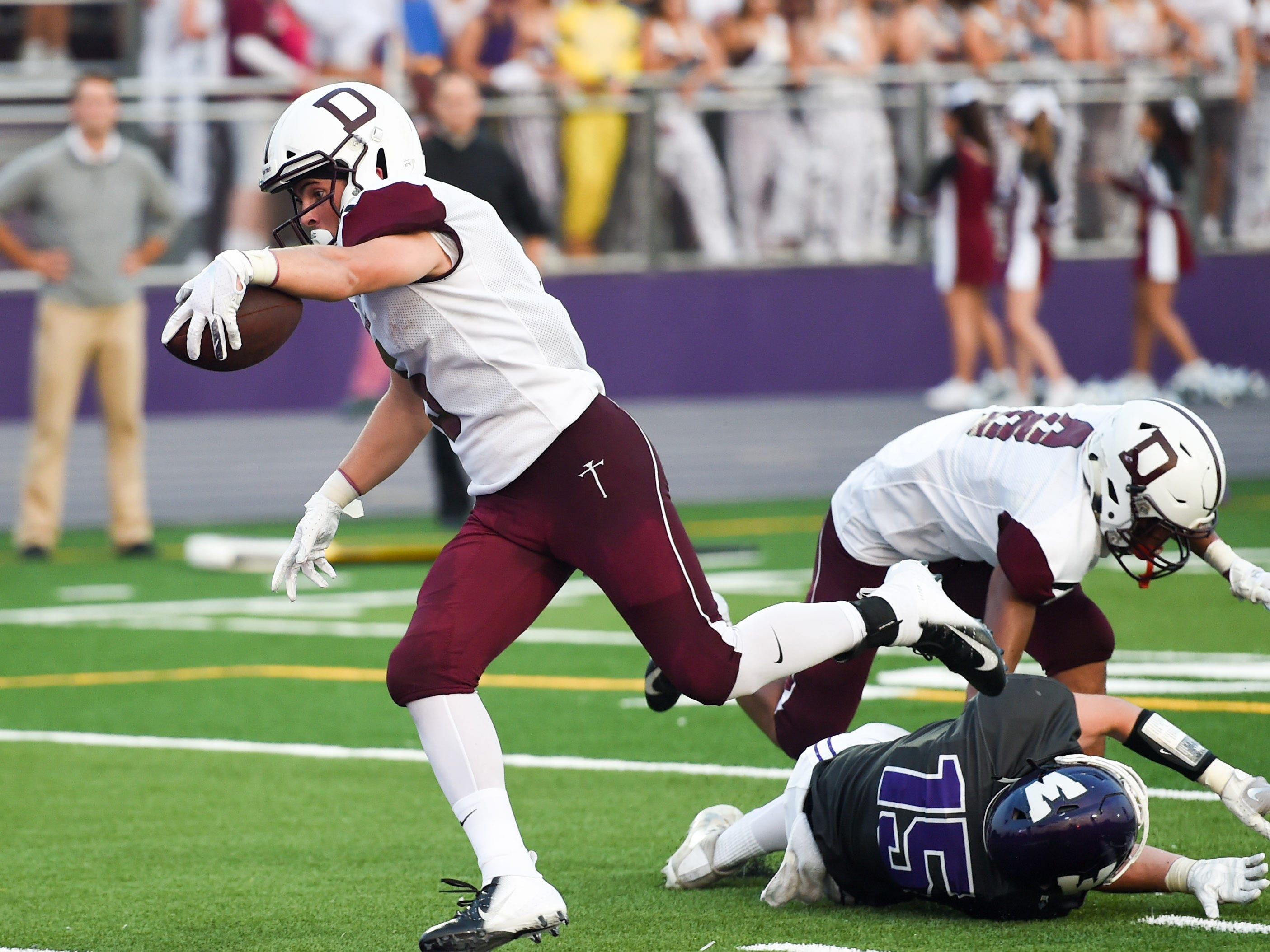 Dowling's Collin Cook (5) breaks through for a touchdown on Friday, August 24, 2018 during a football game between the Waukee Warriors and the Dowling Catholic Maroons at Waukee High School.