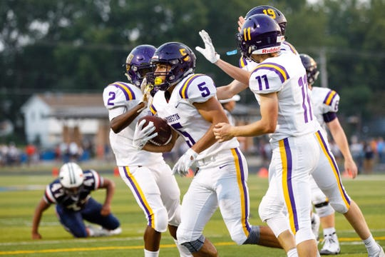 Johnston High School's Anthony Coleman (5) celebrates a touchdown on Urbandale in the second quarter Friday, Aug. 24, 2018, during their game in Urbandale.