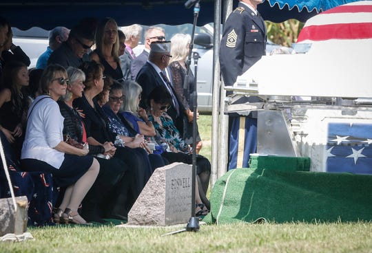 Family of Leonard and Dody Boswell mourn during the funeral services for the former congressman at Rose Hill Cemetery in Lamoni on Saturday, Aug. 24, 2018.