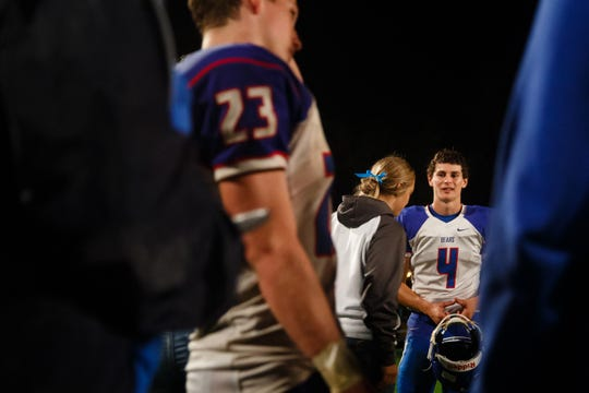 Scott Tibbetts, right, talks to friends on the field after leading B-G-M to a 35-24 win over Lisbon during the first week of high school football in Iowa on Friday, Aug. 24, 2018, in Lisbon. Tibbetts' sister, Mollie, went missing on July 18. Her body was found Aug. 21 in a field outside Guernsey.