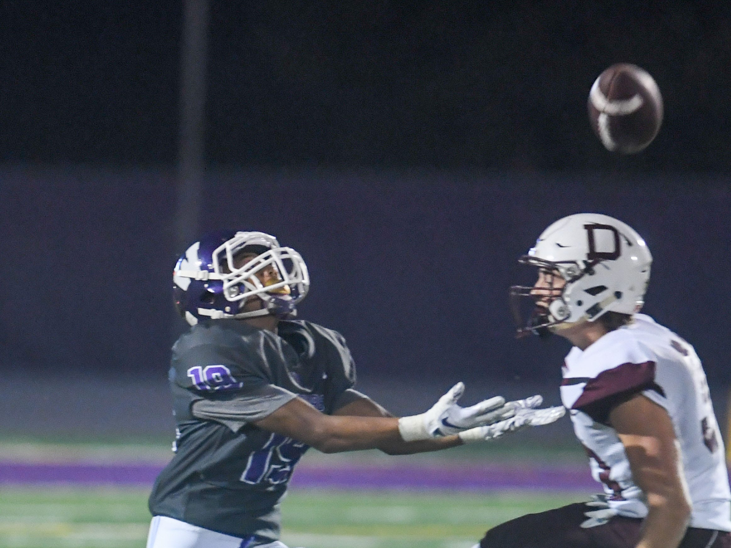 Waukee punt returner Zach Gaines (19) goes in for a catch on Friday, August 24, 2018 during a football game between the Waukee Warriors and the Dowling Catholic Maroons at Waukee High School.