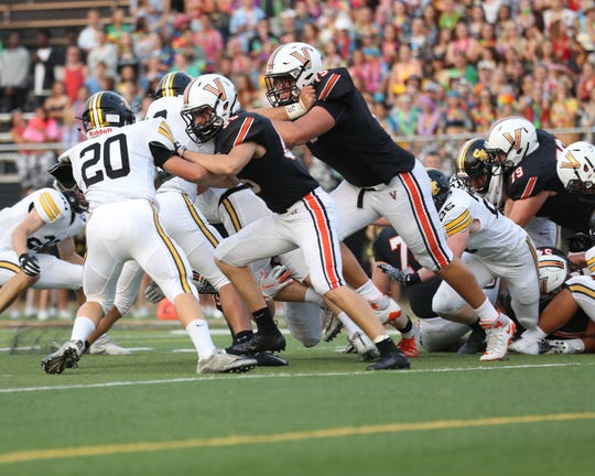 Valley's Jake Remsburg (75) battles in the trenches against Southeast Polk on Friday, Aug, 24, 2018, at Valley Stadium Stadium in West Des Moines.