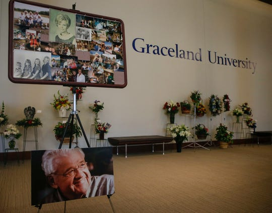 A photo memorial honors the lives of former congressman Leonard Boswell and his wife, Dody, during a memorial service at Graceland University in Lamoni on Saturday, Aug. 24, 2018.