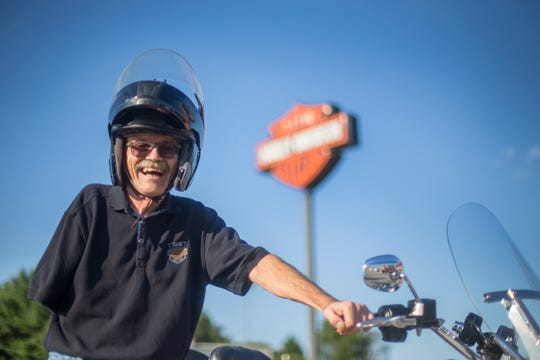 Jim Budzinski, 61, from Dover, Pennsylvania, with his 2017 modified Harley-Davidson Freewheeler at 1st Capital Harley Davidson in York, Pennsylvania, on Friday. Budzinski lost his arm in 2012 and adapted his motorcycle to keep driving. He will depart Wednesday to Milwaukee to celebrate Harley-Davidson 115.