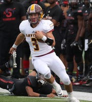 Davison's Cal Stefanko runs by Southfield A&T during the first half Friday, Aug. 24, 2018, at Tom Adams Field on the Wayne State campus in Detroit.