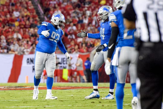 Aug. 24, 2018 in Tampa, Fla.: Detroit Lions defensive tackle Sylvester Williams, left, celebrates with Ziggy Ansah after sacking Tampa Bay Buccaneers quarterback Ryan Fitzpatrick during the first half at Raymond James Stadium.