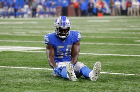 Detroit Lions linebacker Steve Longa holds his leg after being injured during the second half of a preseason game at Ford Field on Aug. 17, 2018.