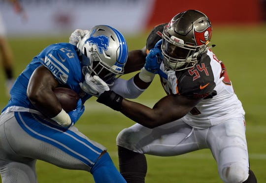 Tampa Bay Buccaneers linebacker Lavonte David tackles Detroit Lions running back Theo Riddick during the first half of an NFL preseason game Friday, Aug. 24, 2018, in Tampa, Fla.