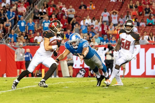 Tampa Bay Buccaneers receiver Adam Humphries weaves past Detroit Lions long snapper Don Muhlbach on his way to 109-yard TD return on a missed field goal to end the first half at Raymond James Stadium on Aug. 24, 2018 in Tampa, Fla.
