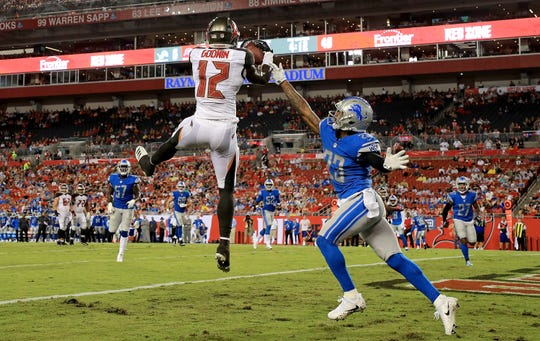 Chris Godwin of the Tampa Bay Buccaneers scores a touchdown over Darius Slay of the Detroit Lions during a preseason game at Raymond James Stadium on Aug. 24, 2018 in Tampa, Fla.