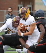 Davison's Cannon Hall is tackled by Southfield A&T's Devin Baldwin during the first half Friday, Aug. 24, 2018, at Tom Adams Field on the Wayne State campus in Detroit.