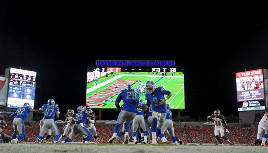 Matthew Stafford hands off to LeGarrette Blount during the Detroit Lions preseason game against the Tampa Bay Buccaneers at Raymond James Stadium on Aug. 24, 2018 in Tampa, Fla.