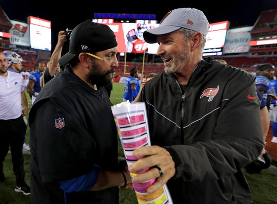 Detroit Lions head coach Matt Patricia greets Tampa Bay Buccaneers head coach Dirk Koetter as they shake hands following a preseason game at Raymond James Stadium on Aug. 24, 2018 in Tampa, Fla.