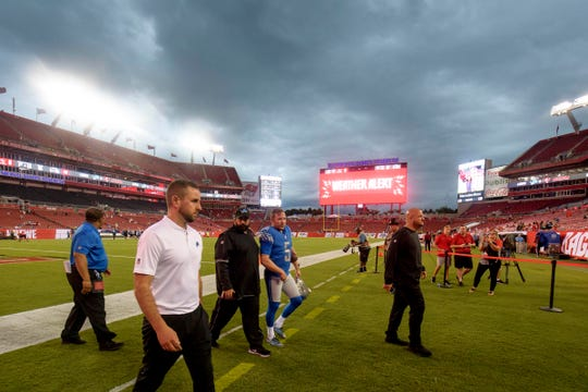 Aug. 24, 2018 in Tampa, Fla.: Detroit Lions head coach Matt Patricia, center, and kicker Matt Prater (5) exit the field due to a weather alert prior to the game against the Tampa Bay Buccaneers at Raymond James Stadium.