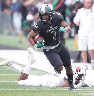 Detroit Cass Tech's Jaren Mangham runs past the River Rouge defense Saturday at Adams Field on the Wayne State campus in Detroit.