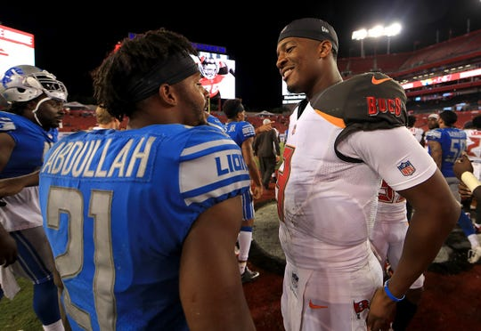 Jameis Winston, right, and Ameer Abdullah talk following a preseason game Friday.