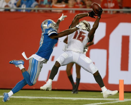 Buccaneers receiver Freddie Martino beats Lions defensive back Nevin Lawson for a touchdown during the second half Friday.