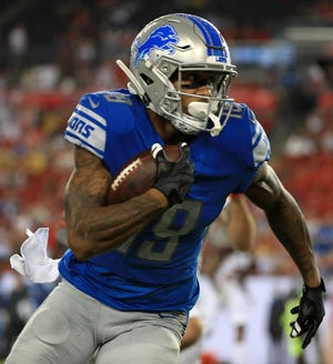 Detroit Lions WR Kenny Golladay runs after a catch during a preseason game against the Tampa Bay Buccaneers at Raymond James Stadium on Aug. 24, 2018 in Tampa, Fla.