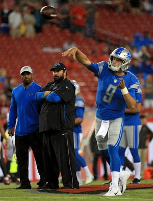 Detroit Lions head coach Matt Patricia watches Matthew Stafford warm up before a preseason game against the Tampa Bay Buccaneers at Raymond James Stadium on Aug. 24, 2018 in Tampa, Fla.