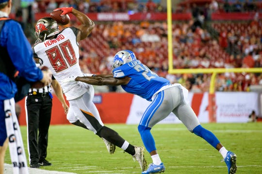 Aug. 24, 2018 in Tampa, Fla.: Tampa Bay Buccaneers tight end O.J. Howard makes a catch along the sideline and is pushed out of bounds by Detroit Lions cornerback Nevin Lawson during the first half at Raymond James Stadium.