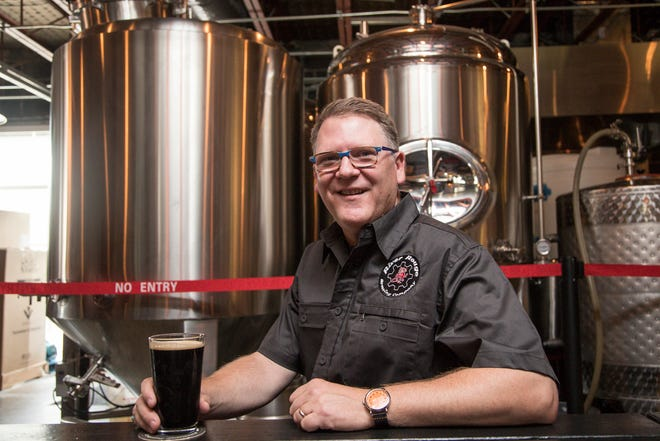 Edward Stencel, owner of River Rouge Brewing Company poses for a photo inside of the brewery in Royal Oak, Friday, August 24, 2018.