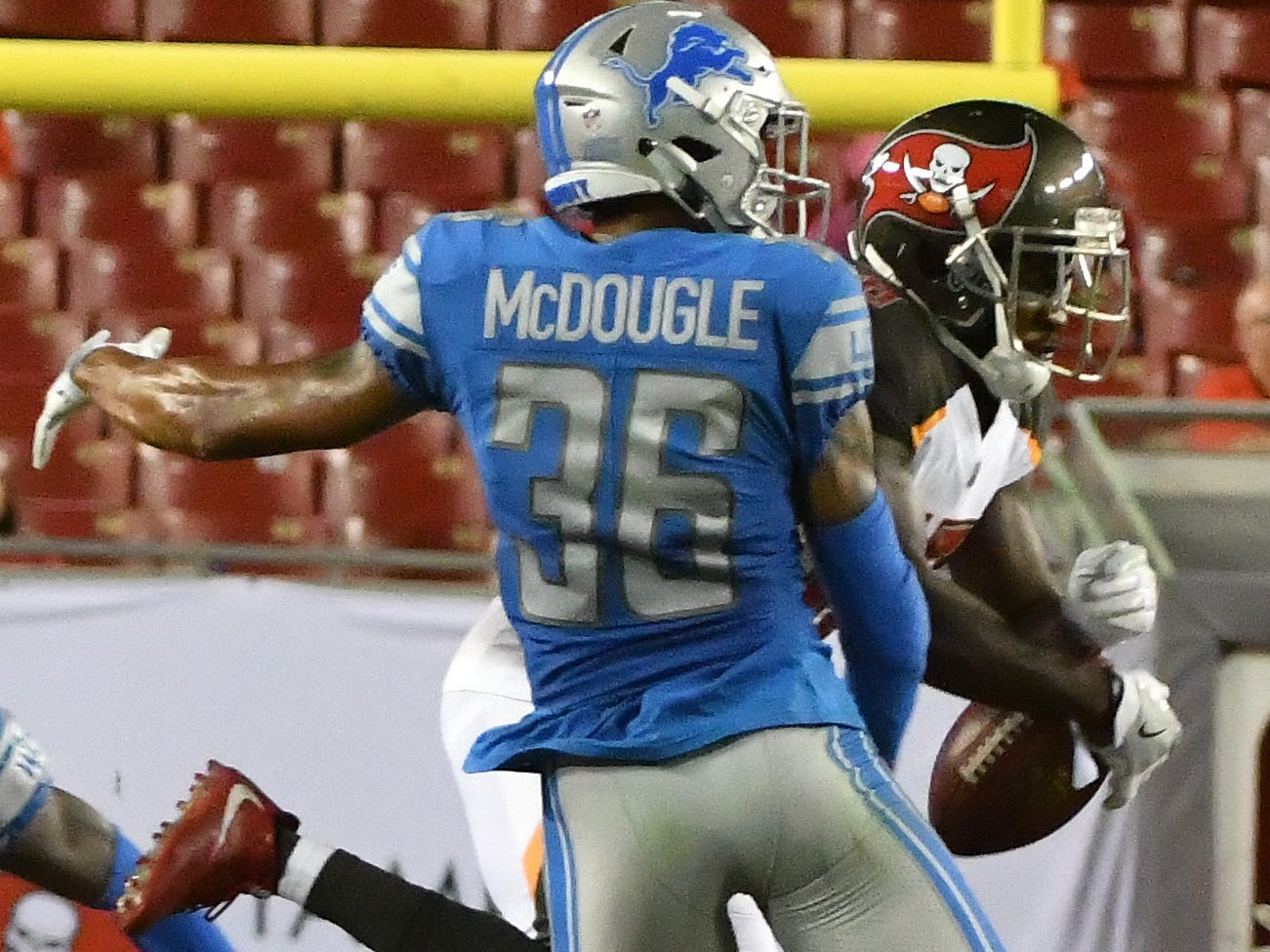 Lions corner back Dexter McDougle breaks up a pass intended for Buccaneers' Bernard Reedy in the fourth quarter.