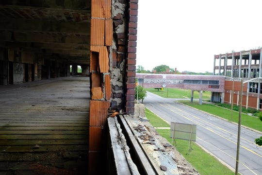 Developers showcase the first phase of cleaning up the former Packard Plant administration building.