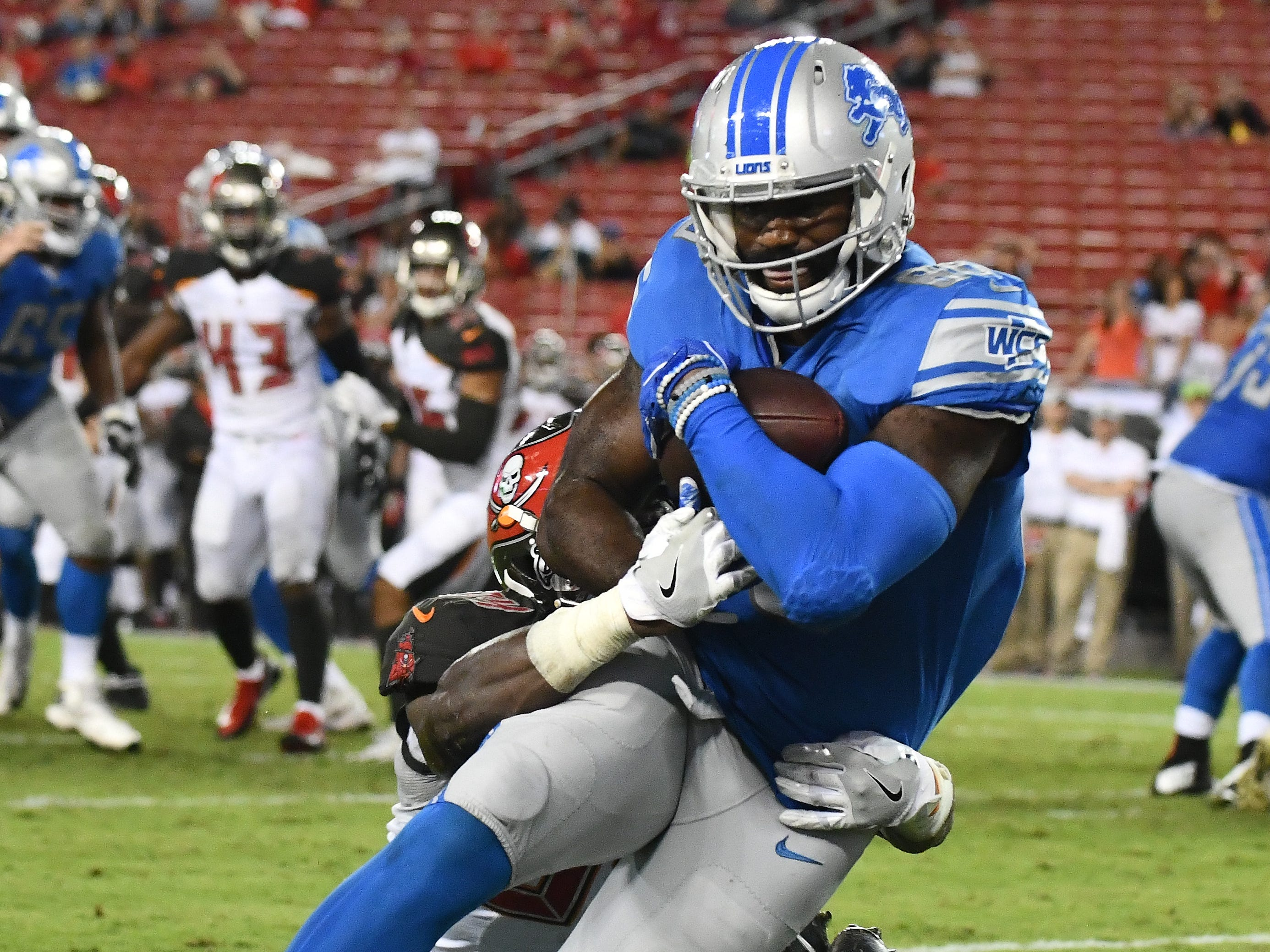 Lions' Marcus Lucas runs into the end zone for the go-ahead touchdown, with defense by Buccaneers' Godwin Igwebuike, as the Lions beat the Tampa Bay Buccaneers 33-30 at Raymond James Stadium in Tampa, Florida on August 24, 2018.