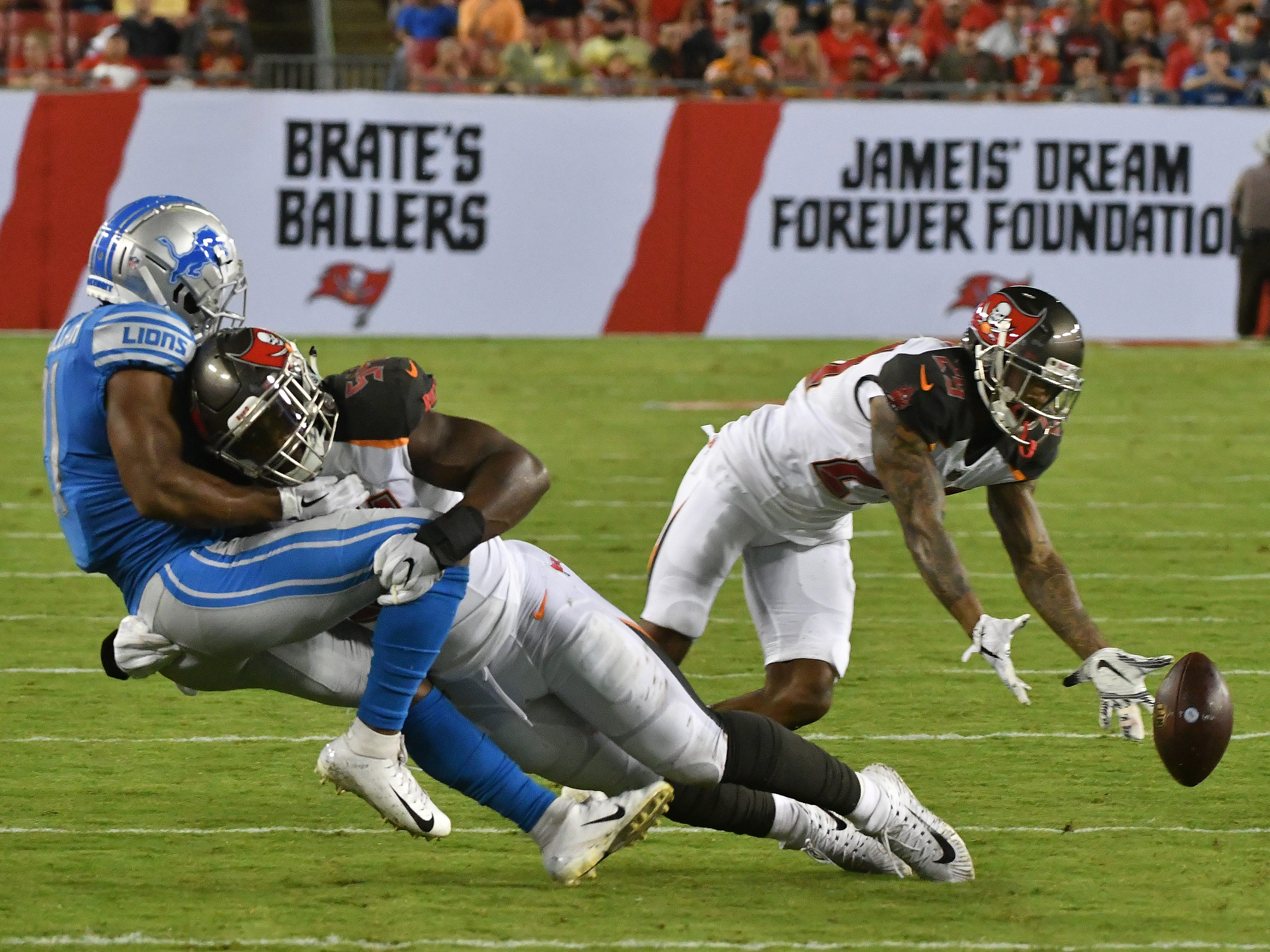 Lions Ameer Abdullah loses the ball after getting hit in the second quarter.