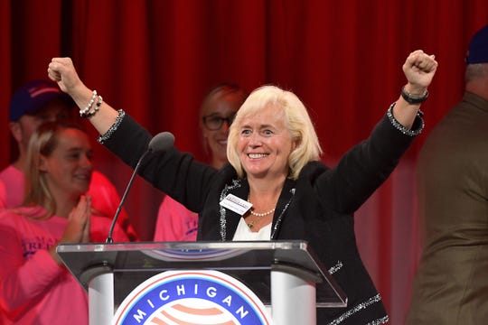 Michigan GOP  Secretary of State candidate Mary Treder Lang celebrates her nomination at the conclusion of the 2018 Republican State Convention in Lansing Saturday August 25, 2018.