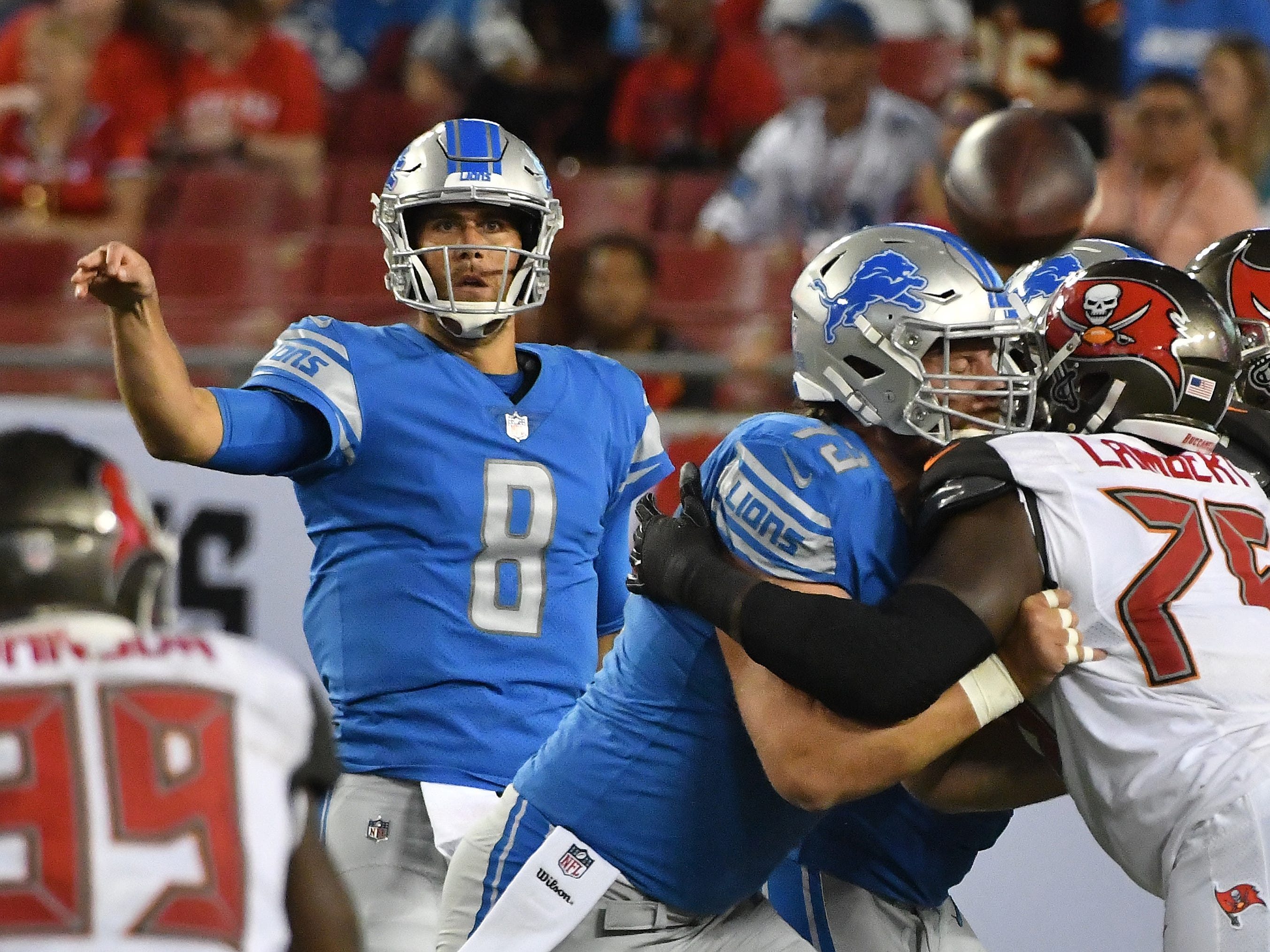 Lions quarterback Matt Cassel throws over the pile in front of him in the third quarter.