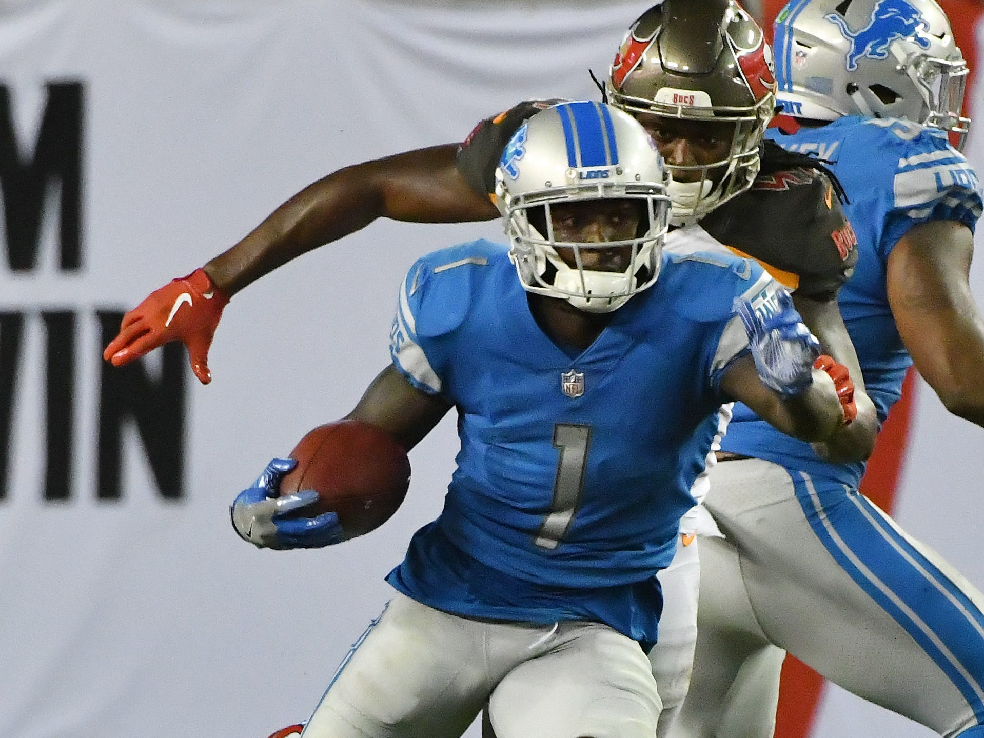 Lions' Brandon Powell runs a punt back to the end zone for a touchdown in the fourth quarter.