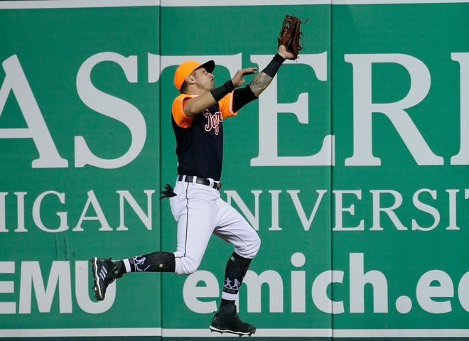 Right fielder Nick Castellanos of the Detroit Tigers catches a fly ball hit by Tim Anderson of the Chicago White Sox during the fourth inning Friday at Comerica Park.