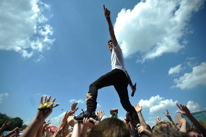 Kyle Pavone performs at the Vans Warped Tour at the Palace of Auburn Hills in 2013.