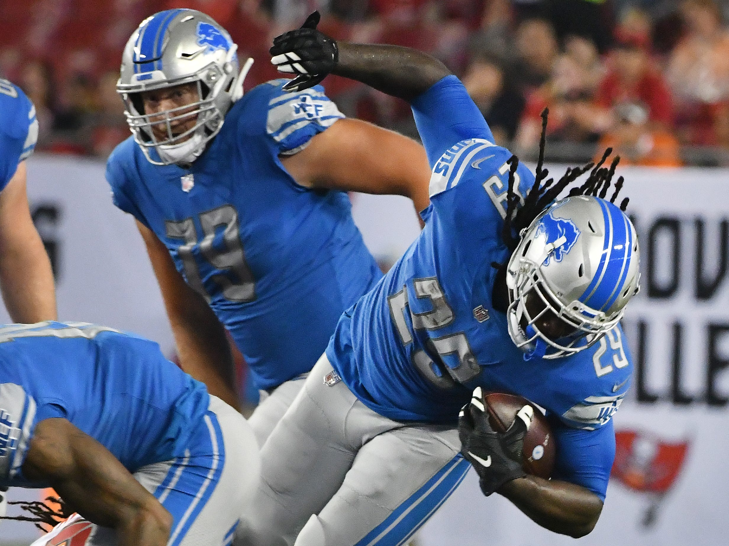 LIons' LeGarrette Blount is upended in the first quarter.