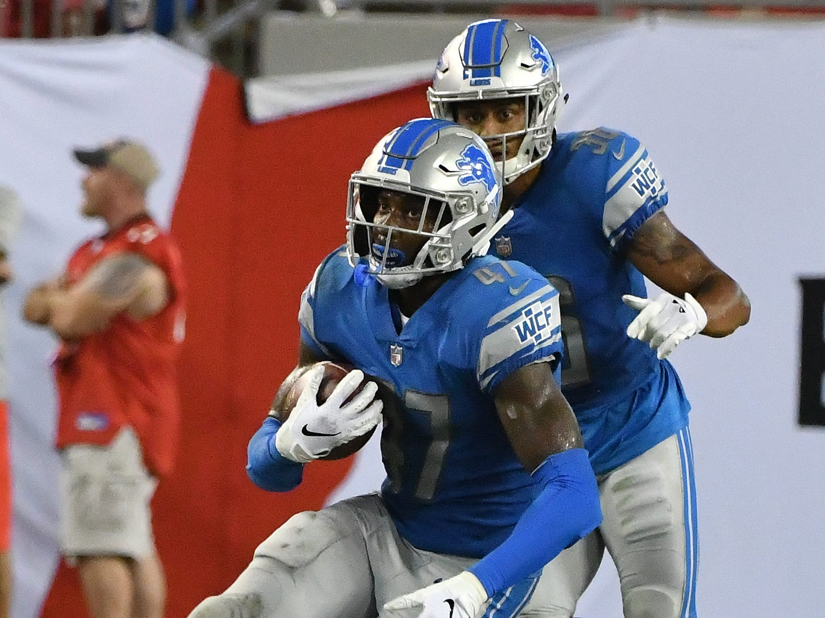 Lions' Tracy Walker intercepts Buccaneers quarterback Austin Allen pass to end the game with a Lions victory, 33-30.