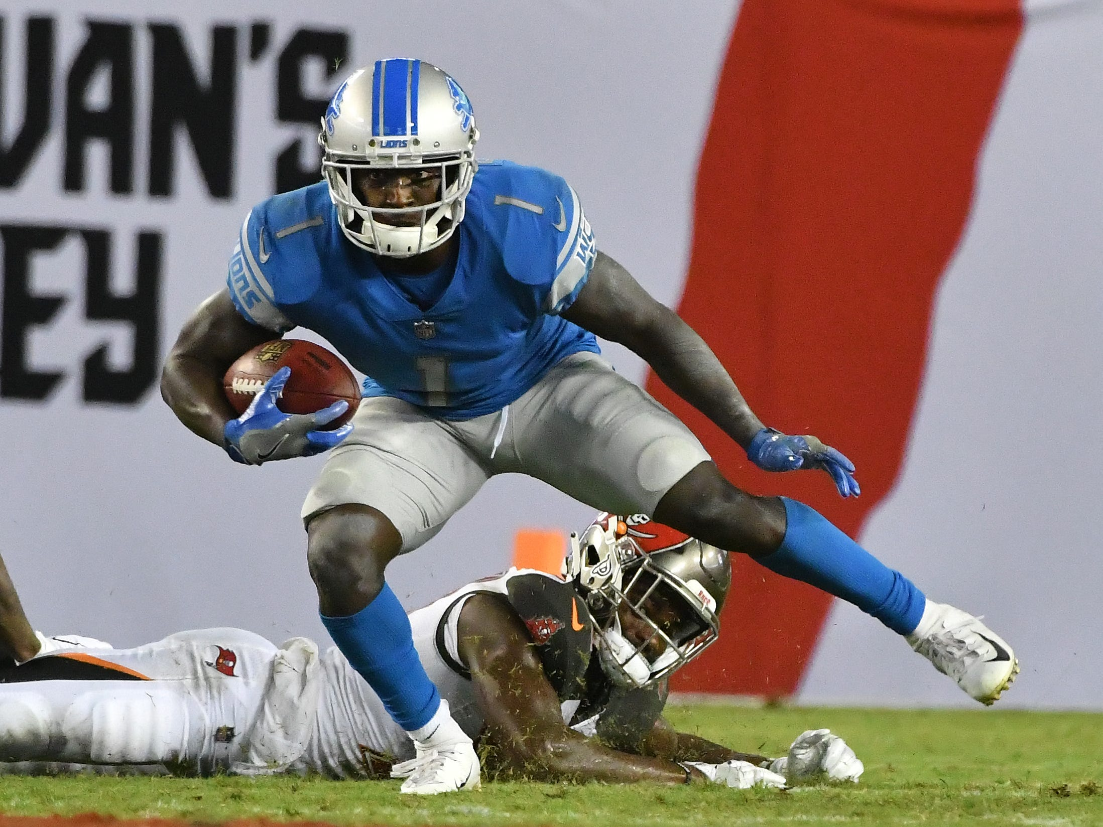 Lions' Brandon Powell breaks a tackle heading up field in the third quarter.