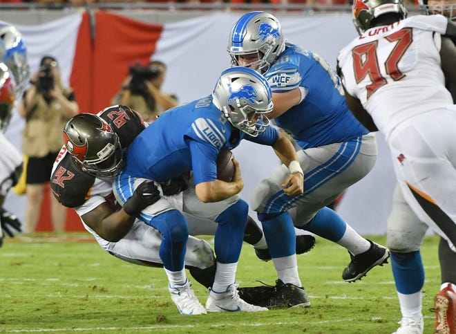 Buccaneers' William Gholston sacks Lions quarterback Matthew Stafford in front of Graham Glasgow in the second quarter of Friday's preseason game.