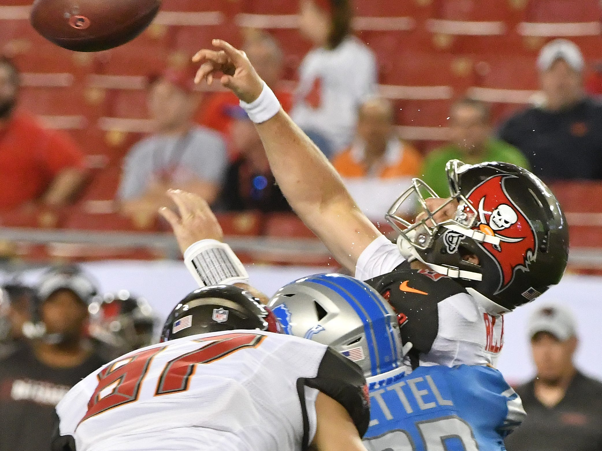 Lions' Anthony Zettel nails Buccaneers quarterback Austin Allen for an incompletion in the fourth quarter.